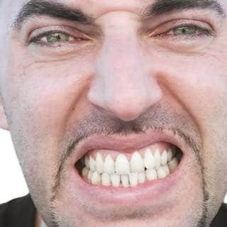 صك الأسنان